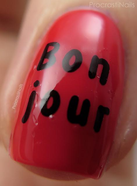 Nail art featuring red nail polish and a rabbit water decal