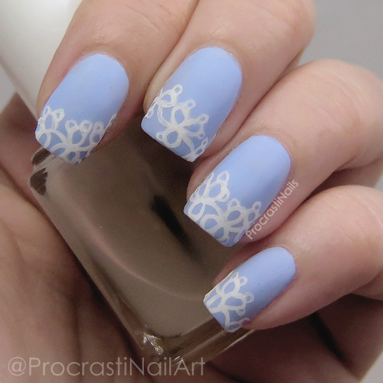 Blue and white nail art with a tatted lace design