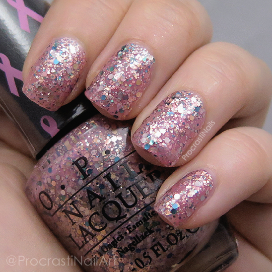 Swatch of a soft pink crelly OPI polish packed with multicoloured glitter