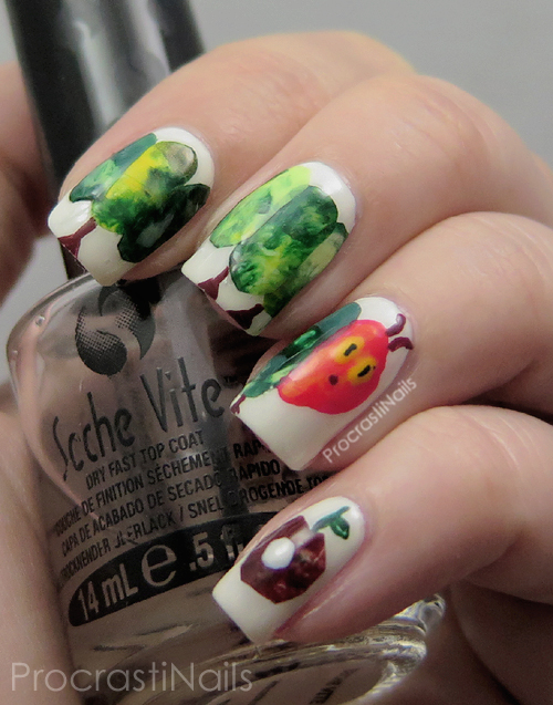 Nail art featuring The Very Hungry Caterpillar and an apple