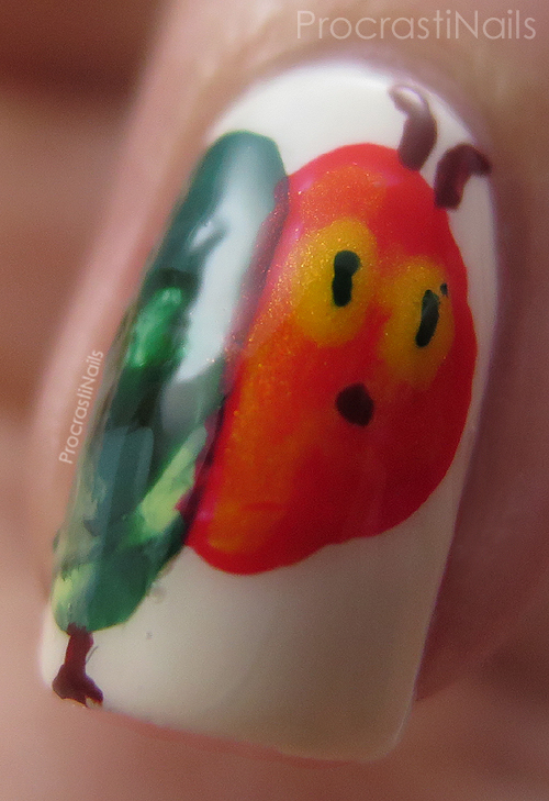 Nail art with the head of The Very Hungry Caterpillar
