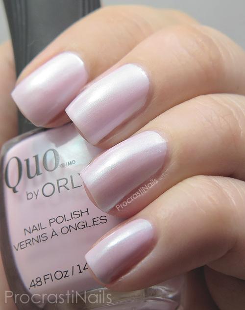 Soft pink nail polish with blue shimmer