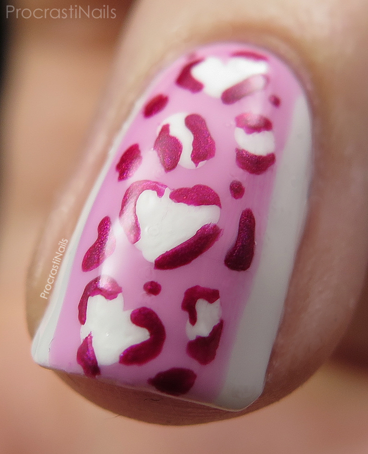 Macro shot of my Valentine's Day nail art with heart shaped leopard spots and colour blocking