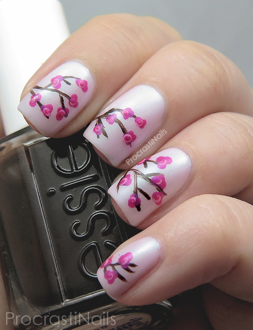 Cherry blossom nail art with pink and brown polish