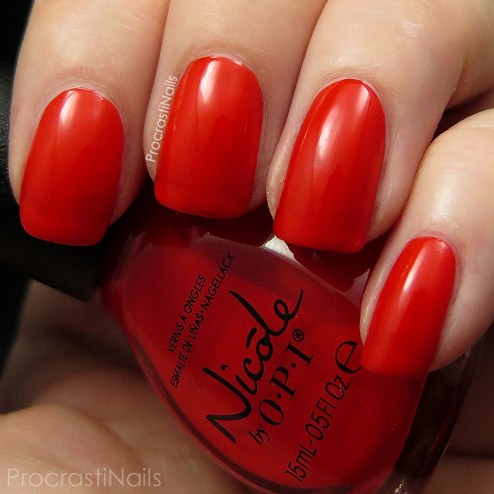 Swatch of the redish orange Nicole by OPI My Claim to Flame