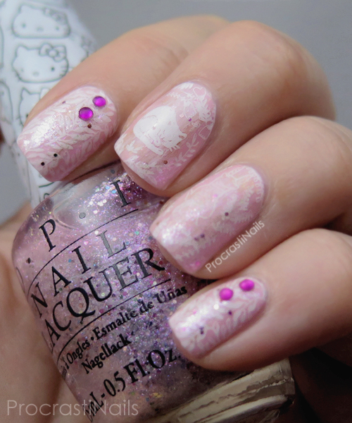 Nail art with white cats stamped over a pink OPI base
