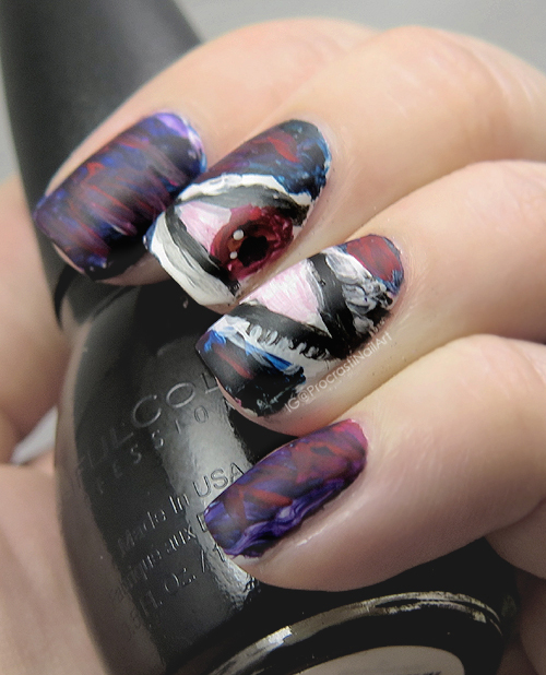 Free-handed nail art with a vampy sexy eye