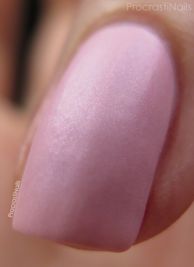 Swatch of Essie Just Stitched a soft pink matte nail polish with shimmer