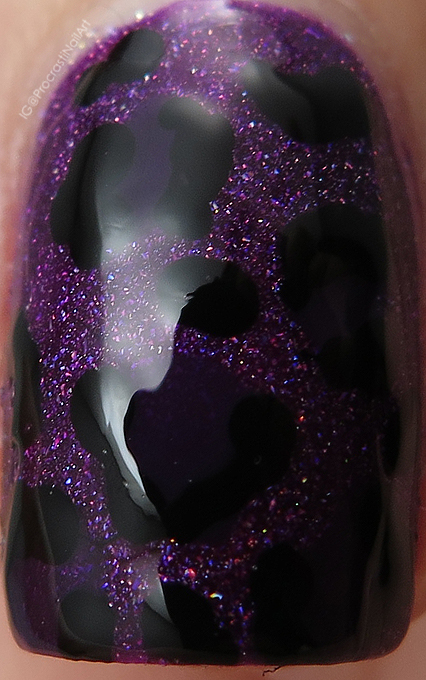 Vampy purple nail art with leopard print and holo