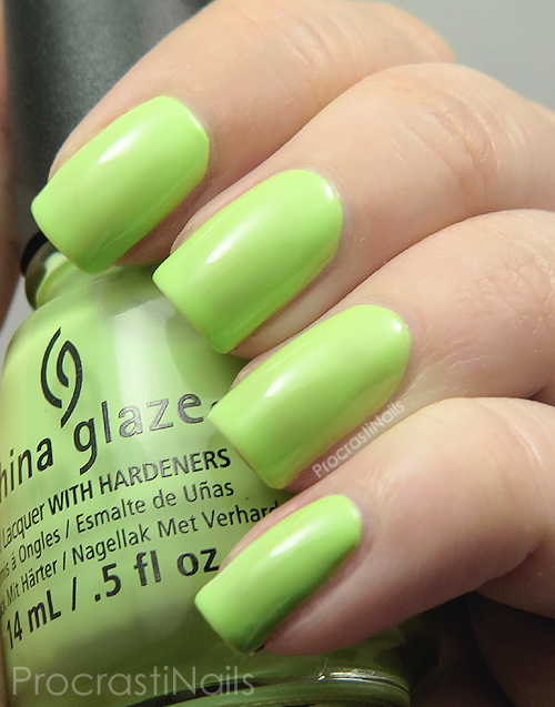 Swatch of the light neon green nail polish China Glaze Be More Pacific